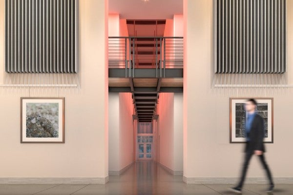 rendering of person walking through gallery lobby entrance