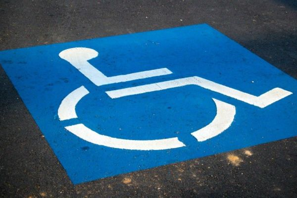 Handicapped Parking Sign Photo by AbsolutVision on Unsplash